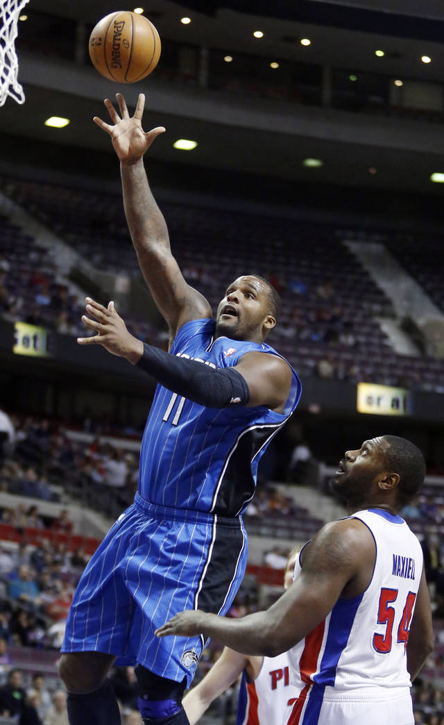Orlando Magic forward Glen Davis (11) takes a shot over Detroit Pistons forward Jason Maxiell (54) in the first half of an NBA basketball game Tuesday, Jan. 22, 2013, in Detroit. (AP Photo/Duane Burleson)