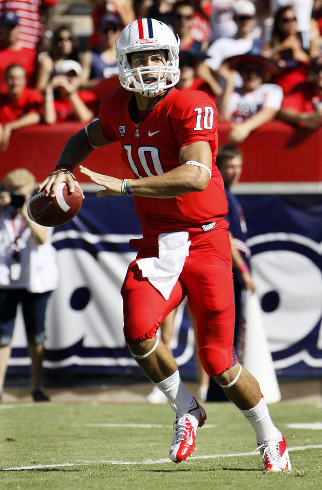 Arizona starting quarterback Matt Scott scrambles during the first quarter of an NCAA college football game against Southern California at Arizona Stadium in Tucson, Ariz., Sat., Oct. 27, 2012. (AP Photo/Wily Low)