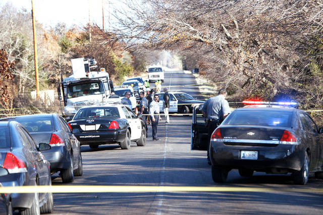 Oklahoma city police investigate a body found Wedneday along E Wilshire Boulevard near Air Depot. Photo By David McDaniel, The Oklahoman
