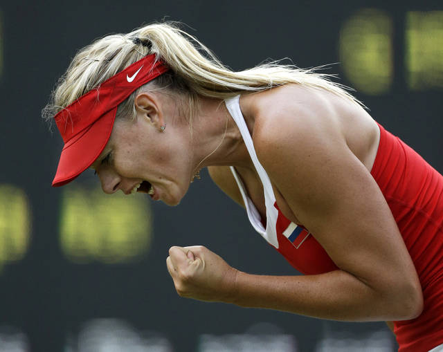 Maria Sharapova of Russia yells after winning a game against Sabine Lisicki of Germany at the All England Lawn Tennis Club at Wimbledon, in London, at the 2012 Summer Olympics, Wednesday, Aug. 1, 2012. (AP Photo/Mark Humphrey)