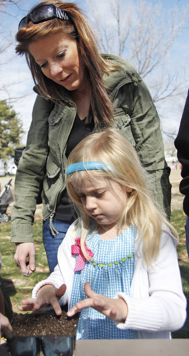 Melissa Eckroat assists Lily Hutsell, 5, with seed planting during the Farm Festival at the Edmond History Society and Museum and Stephenson Park Saturday, March 3, 2012. Photo by Doug Hoke, The Oklahoman