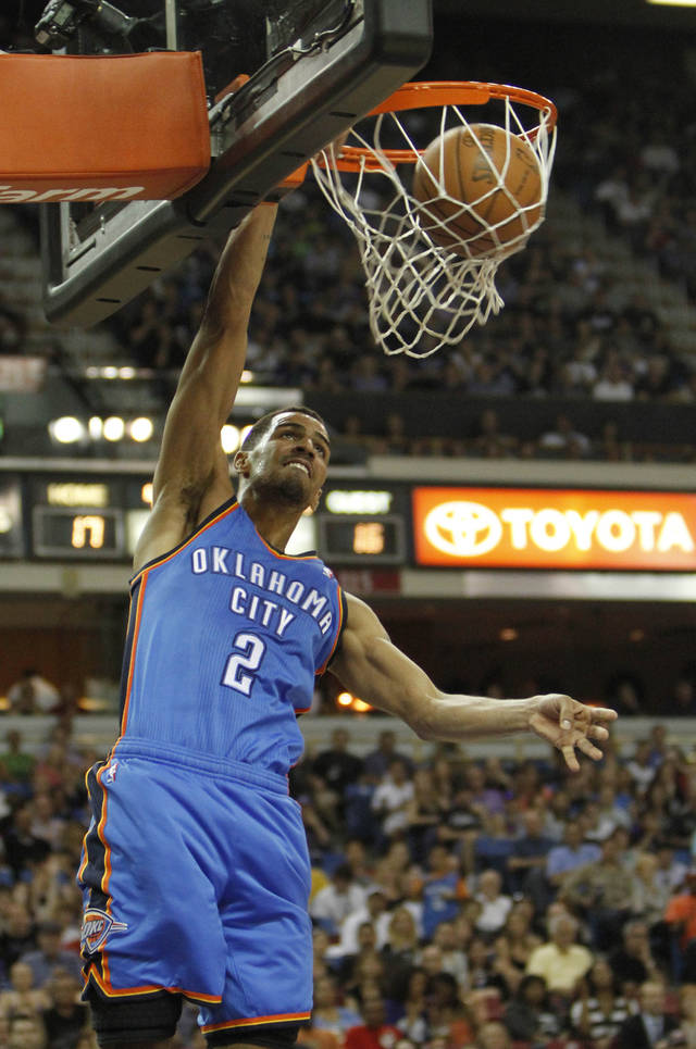 Oklahoma City Thunder guard Thabo Sefolosha, of Switzerland, stuffs during the first quarter of an NBA basketball game against the Sacramento Kings in Sacramento, Calif., Friday, April 20, 2012. (AP Photo/Rich Pedroncelli) ORG XMIT: SCA102