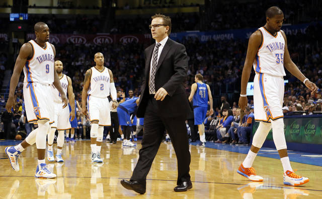 Oklahoma City's Serge Ibaka (9), Derek Fisher (6), Caron Butler (2) and Kevin Durant (35) walk to the bench area for a third-quarter timeout called by coach Scott Brooks, middle, during an NBA basketball game between the Oklahoma City Thunder and the Dallas Mavericks at Chesapeake Energy Arena in Oklahoma City, Sunday, March 16, 2014. Dallas won, 109-86. Photo by Nate Billings, The Oklahoman