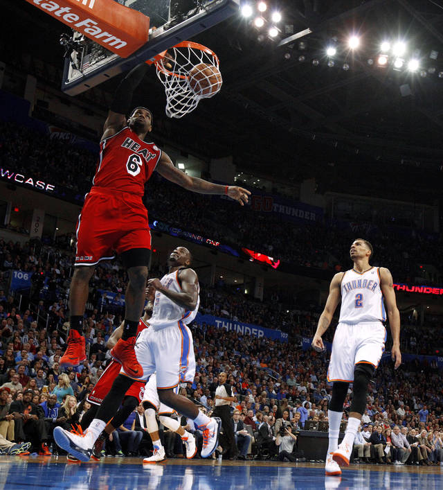 Miami's LeBron James (6) dunks the ball as Oklahoma City's Kendrick Perkins (5) and Thabo Sefolosha (2) watch during an NBA basketball game between the Oklahoma City Thunder and the Miami Heat at Chesapeake Energy Arena in Oklahoma City, Thursday, Feb. 15, 2013. Miami won 110-100. Photo by Bryan Terry, The Oklahoman