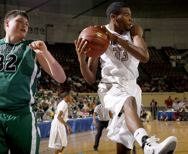 Northeast's Omarkio Collins grabs a rebound beside Haworth's Eric Gembill during the Class 2A boys high school state basketball championship game at State Fair Arena in Oklahoma City, Saturday, March 10, 2012. Photo by Bryan Terry, The Oklahoman