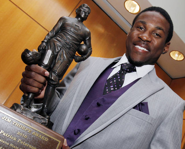 Patrick Peterson of Louisiana State University, the 2010 Jim Thorpe Award winner, poses for a photo with the trophy before the Jim Thorpe Award banquet at the National Cowboy & Western Heritage Museum in Oklahoma City, Monday, Feb. 7, 2011. The Jim Thorpe Award is given by the Jim Thorpe Association to the top defensive back in college football. Photo by Nate Billings, The Oklahoman ORG XMIT: KOD