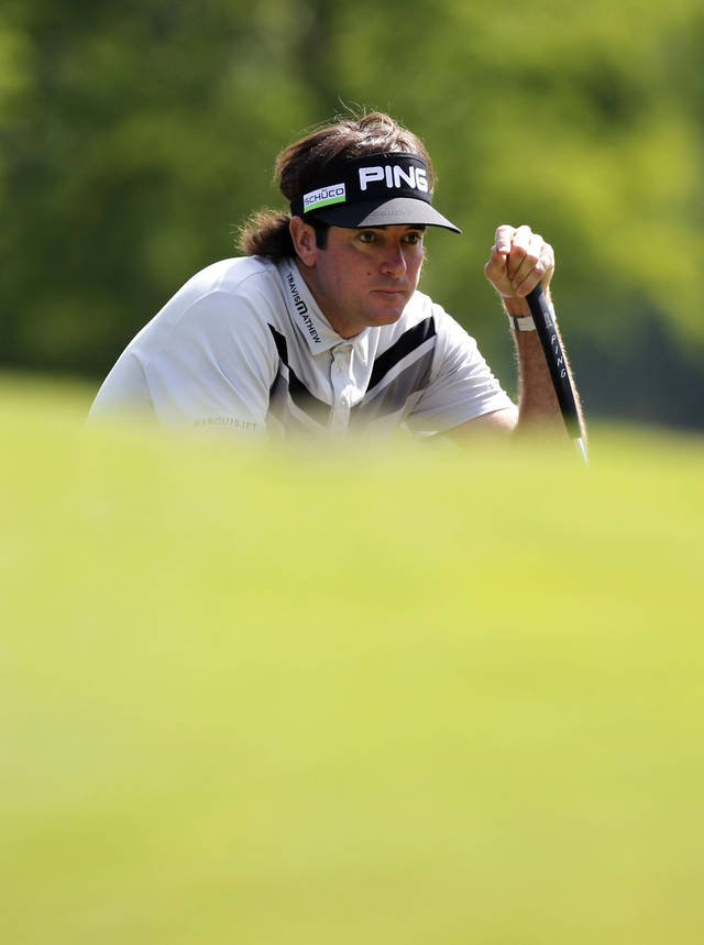 Bubba Watson, recent Masters champion and defending Zurich Classic champion, lines up a shot out of a sand trap on the second hole during the first round of the Zurich Classic golf tournament at TPC Louisiana in Avondale, La., Thursday, April 26, 2012. (AP Photo/Gerald Herbert)
