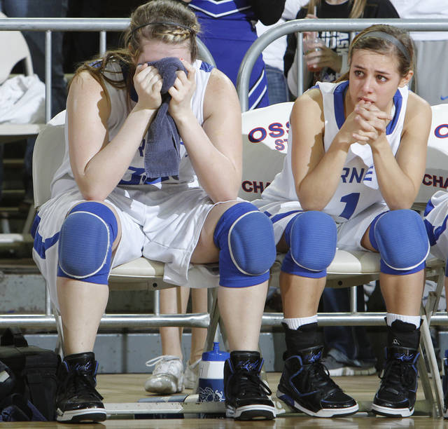 Vinita's Halie Liggett (32) and Terri Markham react in the final seconds of the Hornets loss to Anadarko during the semifinal 4A girls State Basketball Championship game between Anadarko and Vinita at the State Fair Arena on Friday, March 9, 2012 in Oklahoma City, Okla.  Photo by Chris Landsberger, The Oklahoman