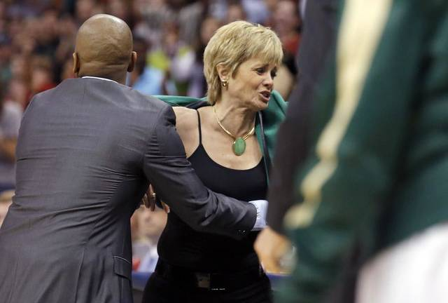 Baylor's head coach Kim Mulkey is restrained by an assistant coach during college basketball game between Baylor University and the Louisville at the Oklahoma City Regional for the NCAA women's college basketball tournament at Chesapeake Energy Arena in Oklahoma City, Sunday, March 31, 2013. Photo by Sarah Phipps, The Oklahoman