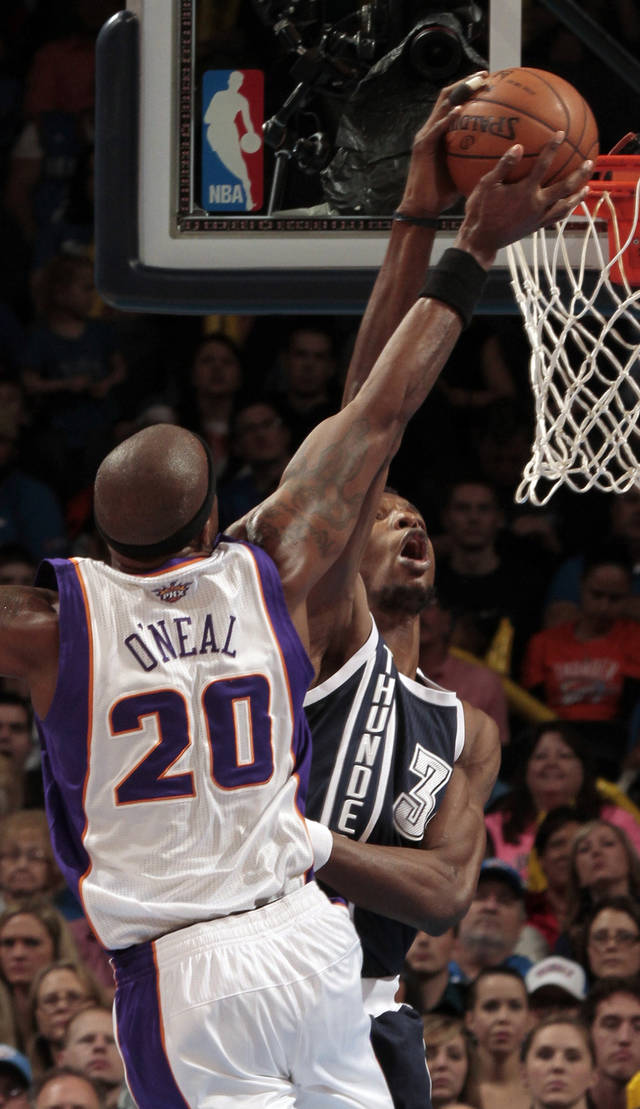 Oklahoma City Thunder's Hasheem Thabeet (34) blocks a shot by Phoenix Suns' Jermaine O'Neal (20) as the Oklahoma City Thunder play the Phoenix Suns in NBA basketball at the Chesapeake Energy Arena in Oklahoma City, on Monday, Dec. 31, 2012.  Photo by Steve Sisney, The Oklahoman