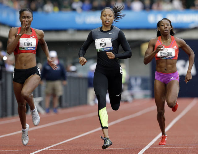 Allyson Felix finishes her heat in the women's 200 meters at the U.S. Olympic Track and Field Trials Thursday, June 28, 2012, in Eugene, Ore ahead of Joanna Atkins, left, and Tiffany Townsend. (AP Photo/Eric Gay)