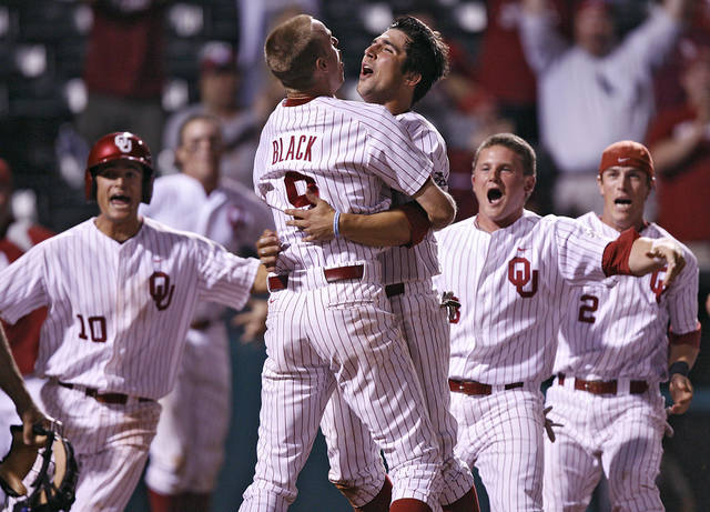 Oklahoma's Tyler Ogle (35) reacts with teammate Danny Black (9) after Ogle's game-winning score during the bottom of the ninth inning in the Sooners' 3-2 win in the fourth game of the Big 12 Baseball Championship between Oklahoma and Kansas at the AT&T Bricktown Ballpark on Wednesday, May 26, 2010, in Oklahoma City, Okla.  Photo by Chris Landsberger, The Oklahoman