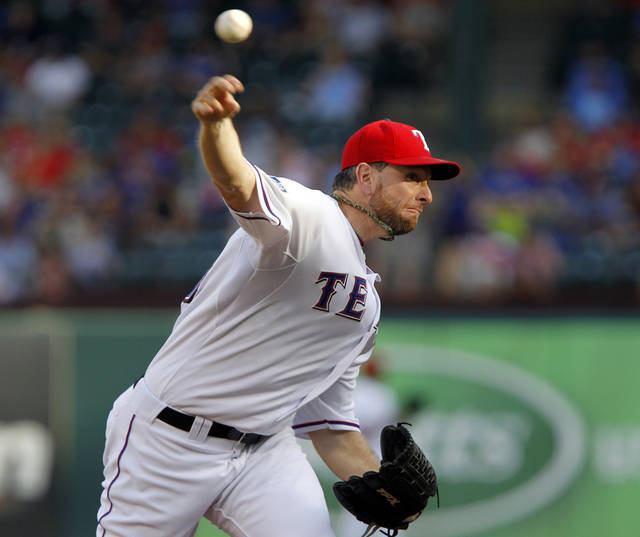Texas Rangers starting pitcher Scott Feldman (39) throws a pitch during the second inning of a baseball game against the Chicago White Sox on Sunday, July 29, 2012, in Arlington, Texas.  (AP Photo/John F. Rhodes)