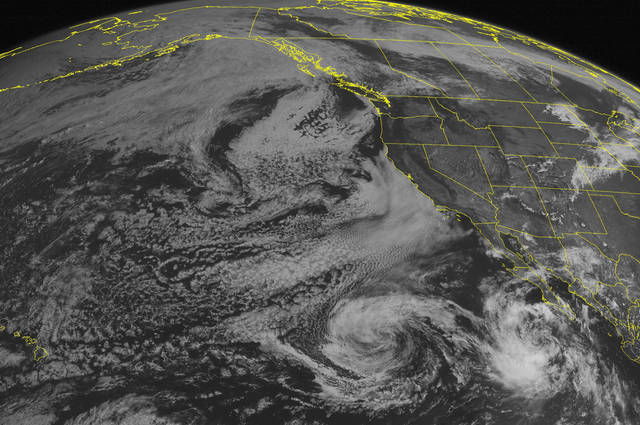 This NOAA satellite image taken Monday, September 03, 2012 at 02:00 PM EDT shows Tropical Storm John has developed about 240 miles southwest of the southern tip of Baja California. The system has maximum sustained winds up to 40 mph and moves northwestward at 13 mph. The system is expected to continue moving northwestward and further away from land. To the north, high pressure over the West Coast maintains offshore flow which pushes moisture and clouds off the coast. A few scattered clouds and thunderstorms develop over the Four Corners as monsoonal moisture lingers over the region. (AP PHOTO/WEATHER UNDERGROUND)