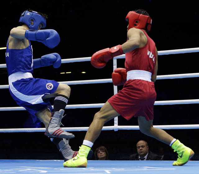 Devendro Singh Laishram of India, right, knocks down Serdamba Purevdorj of Mongolia, during their fight at the men's light flyweight boxing at the 2012 Summer Olympics, Saturday, Aug. 4, 2012, in London. (AP Photo/Ng Han Guan)