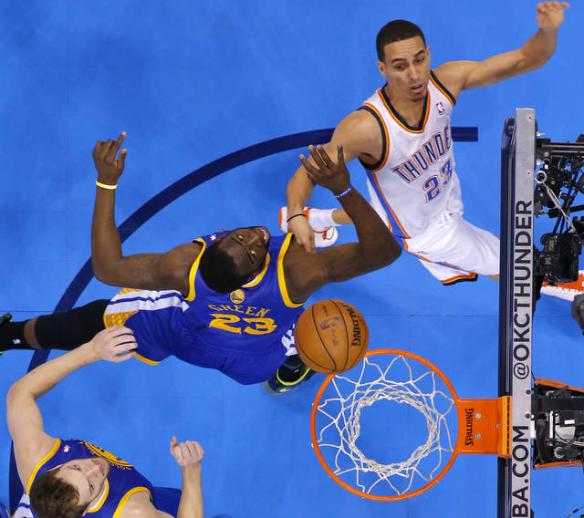 Oklahoma City's Kevin Martin (23) shoots the ball over Golden State's Draymond Green (23) during an NBA basketball game between the Oklahoma City Thunder and the Golden State Warriors at Chesapeake Energy Arena in Oklahoma City, Wednesday, Feb. 6, 2013. Photo by Bryan Terry, The Oklahoman