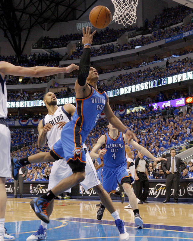 Oklahoma City's Russell Westbrook (0) goes past Tyson Chandler (6) of Dallas during game 1 of the Western Conference Finals in the NBA basketball playoffs between the Dallas Mavericks and the Oklahoma City Thunder at American Airlines Center in Dallas, Tuesday, May 17, 2011. Photo by Bryan Terry, The Oklahoman