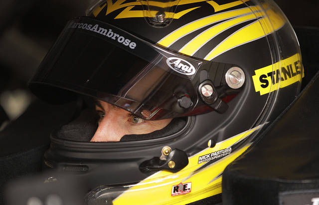 Marcos Ambrose, of Australia, waits for Sunday's NASCAR Sprint Cup Series auto race, Friday, June 22, 2012, in Sonoma, Calif. (AP Photo/Ben Margot)