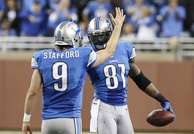 Detroit Lions wide receiver Calvin Johnson (81) is congratulated by quarterback Matthew Stafford in the fourth quarter of an NFL football game against the Atlanta Falcons, after breaking Jerry Rice's single-season record for receiving yards, in Detroit on Saturday, Dec. 22, 2012. (AP Photo/Duane Burleson)