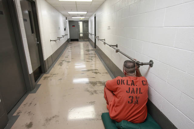 Tour of the Oklahoma City/County Jail, Tuesday, July 5, 2011. An inmate is handcuffed to a rail in the hall. Photo by David McDaniel, The Oklahoman
