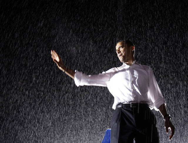 <p>FILE - In this Sept. 27, 2008 file photo, then-presidential candidate Sen. Barack Obama, D-Ill., waves to the crowd at a rally in the rain at the University of Mary Washington in Fredericksburg, Va. Democrats are closely watching the forecasts as a rainy week unfolds ahead of Obama's speech accepting his party's nomination. With Obama set to address supporters in Charlotte's open-air football stadium on Thursday, Sept. 6, 2012 party officials insist the speech will go on even if it rains. After all, they said the stadium's main tenant, the Carolina Panthers NFL team, plays no matter the weather. (AP Photo/Alex Brandon, File)</p>