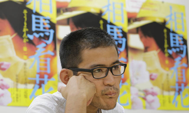 In this Friday, Sept. 7, 2012 photo, Japanese film director Yojyu Matsubayashi speaks during an interview in Tokyo. Matsubayashi took a more standard documentary approach for his �Fukushima: Memories of the Lost Landscape,� interviewing people who were displaced in the Fukushima town of Minami Soma. He followed them into temporary shelters in cluttered gymnasiums and accompanied their harried visits to abandoned homes with the gentle patience of a video-journalist. The March 2011 catastrophe in Japan has set off a flurry of independent films telling the stories of regular people who became overnight victims, stories the creators feel are being ignored by mainstream media and often silenced by the authorities. (AP Photo/Koji Sasahara)