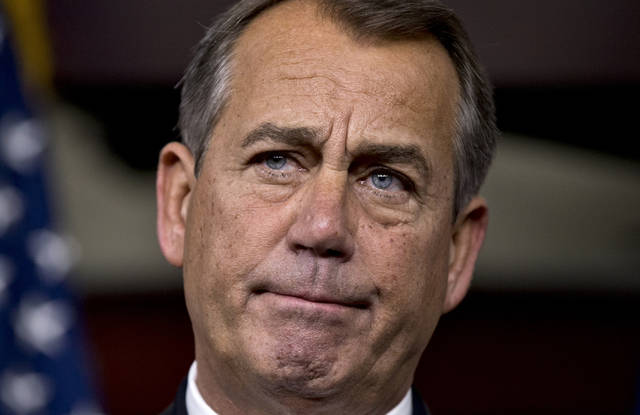 "Speaker of the House John Boehner, R-Ohio, speaks to reporters about the fiscal cliff negotiations at the Capitol in Washington, Friday, Dec. 21, 2012. Hopes for avoiding the ""fiscal cliff"" that threatens the U.S. economy fell Friday after fighting among congressional Republicans cast doubt on whether any deal reached with President Barack Obama could win approval ahead of automatic tax increases and deep spending cuts kick in Jan. 1.  (AP Photo/J. Scott Applewhite)"