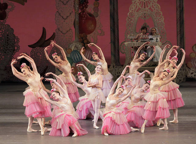 "This publicity image released by Paul Kolnik shows Ashley Bouder, center, and Company in New York City Ballet's production of George Balanchine's ""The Nutcracker."" The New York City Ballet will transmit its ""Nutcracker"" live next week to some 560 movie theaters in 50 states, giving children across the nation a chance to see what many consider the gold standard in ""Nutcrackers."" The company joins a growing trend of HD transmissions of cultural events in movie theaters. (AP Photo/Paul Kolnik)"
