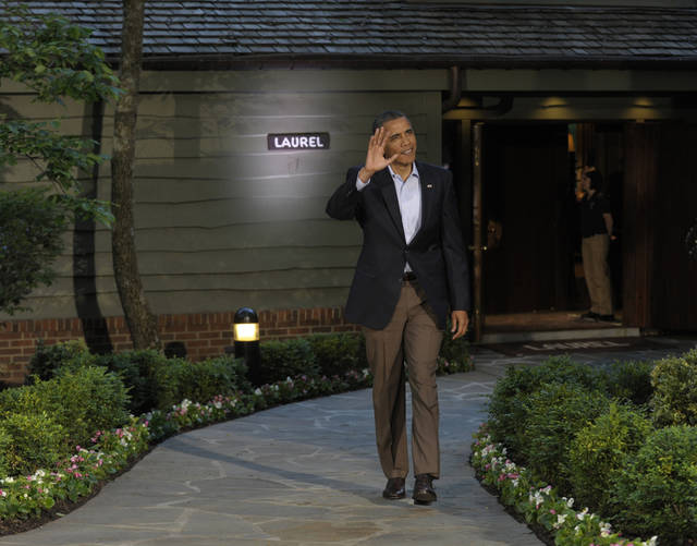 President Barack Obama waves to cameras before greeting world leaders for the G8 Summit Friday, May 18, 2012 at Camp David, Md. (AP Photo/Susan Walsh)