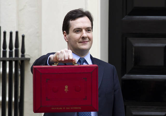 "Britain's Chancellor of the Exchequer George Osborne poses for the media with his traditional red dispatch box outside his official residence at No 11 Downing Street in London, as he departs to deliver his annual budget speech to the House of Commons, Wednesday, March 21, 2012. Later on Wednesday, George Osborne, the U.K.'s finance minister, will unveil his budget, the annual update of the state of the country's economy and the coalition government's plans for taxation and spending for the year. This time round, attention has focused on what Osborne is going to do with the ""50p"" tax, political shorthand for the 50 percent top-rate income tax, on annual income above 150,000 pounds ($238,000). (AP Photo/Matt Dunham)"