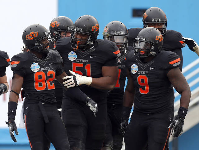 OSU celebrates a Isaiah Anderson (82) touchdown during the Heart of Dallas Bowl football game between the Oklahoma State University (OSU) and Purdue University at the Cotton Bowl in Dallas,  Tuesday,Jan. 1, 2013. Photo by Sarah Phipps, The Oklahoman