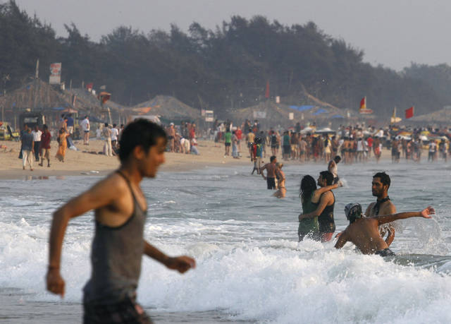 In this March 9, 2013 file photo, tourists play on the Baga Beach in Goa, India, a popular destination among Indian and foreign tourists. The rape and murder of a young woman in New Delhi in December followed by two attacks on foreign female travelers has altered how tourists view India and led to a sharp fall in the numbers of foreign tourists, especially women, a study released Sunday, March 31, 2013 said. (AP Photo/ Rajesh Kumar Singh, File)