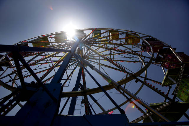 The Ferris Wheel is silhouetted during  Freedom Festival at Eldon Lyon Park in Bethany, Wednesday, July 4, 2012. Photo By Steve Gooch, The Oklahoman