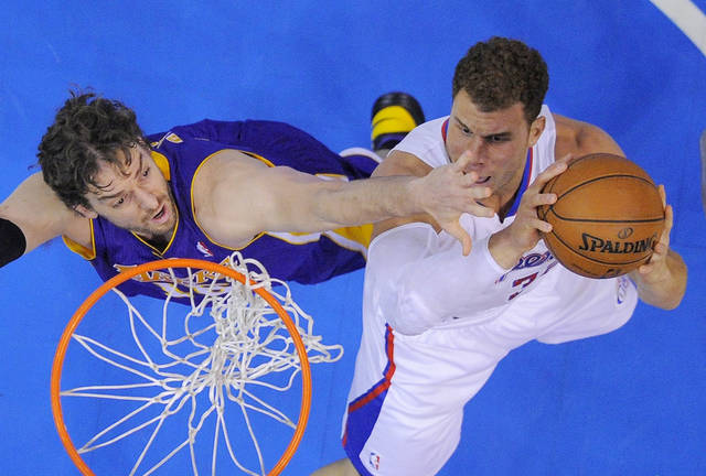 Los Angeles Clippers forward Blake Griffin, right, puts up a shot as Los Angeles Lakers forward Pau Gasol, of Spain, defends during the first half of their NBA basketball game, Friday, Jan. 4, 2013, in Los Angeles.  (AP Photo/Mark J. Terrill)  ORG XMIT: LAS109