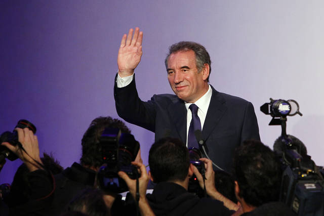 Francois Bayrou, leader of French centrist Democratic Movement, MODEM waves as he arrives to announce officially his campaign for the 2012 presidential elections in Paris, Wednesday, Dec. 7, 2011. (AP Photo/Francois Mori)