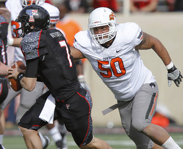 Oklahoma State Cowboys defensive end Jamie Blatnick (50) puts pressure on Texas Tech Red Raiders quarterback Seth Doege (7) during the college football game between the Oklahoma State University Cowboys (OSU) and Texas Tech University Red Raiders (TTU) at Jones AT&T Stadium on Saturday, Nov. 12, 2011. in Lubbock, Texas.  Photo by Chris Landsberger, The Oklahoman  ORG XMIT: KOD