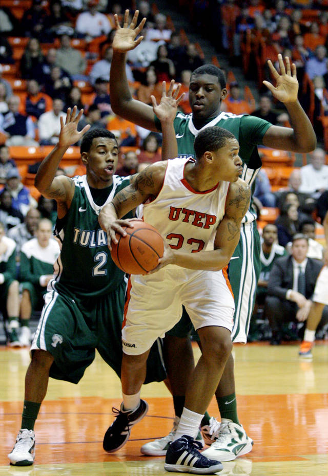 UTEP's Gabriel McCulley looks for room around Tulane's Ricky Tarrant, left, and Lotanna Nwogbo,right, during an NCAA college basketball game, Saturday, Feb. 11, 2012, in El Paso, Texas. (AP Photo/The El Paso Times, Vanessa M Feldman) EL DIARIO OUT; JUAREZ MEXICO OUT