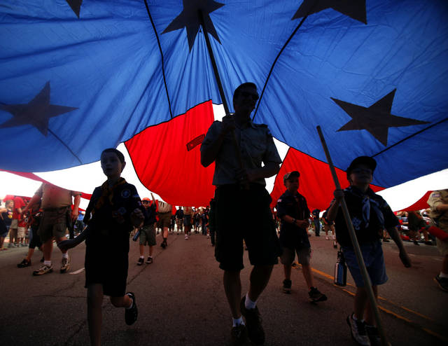 4TH OF JULY / FOURTH OF JULY / ACTIVITIES / FESTIVITIES: Boy Scouts of America and Cub Scout troops carry a large American flag during the LibertyFest Parade in Edmond, Okla., Monday, July 4, 2011. Photo by Sarah Phipps, The Oklahoman ORG XMIT: KOD