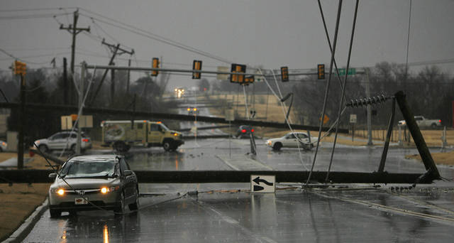 High line poles blown over as cars are on north Penn just south of 150 in Oklahoma City, Tuesday , February 10, 2009.  By David McDaniel, The Oklahoman.