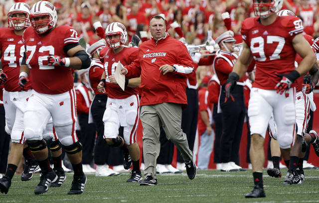 Wisconsin head coach Bret Bielema leads his team on the field before the first half of an NCAA college football game against Northern Iowa Saturday, Sept. 1, 2012, in Madison, Wis. (AP Photo/Morry Gash)