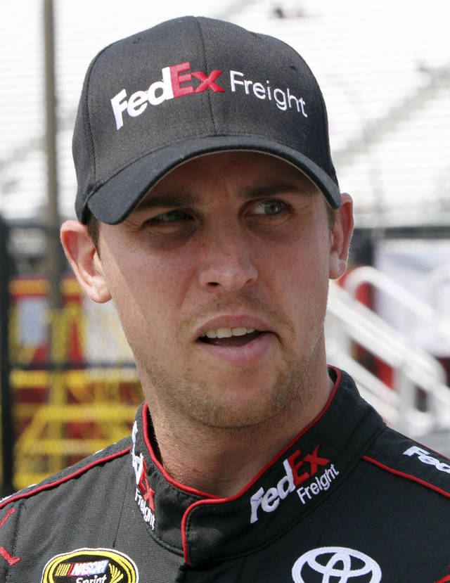 Driver Denny Hamlin gets ready for practice for Sunday's NASCAR Sprint Cup series auto race Friday, July 13, 2012, at New Hampshire Motor Speedway in Loudon, N.H. (AP Photo/Jim Cole)