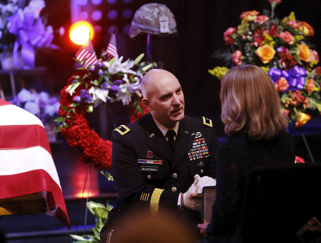 US Army Brig. Gen. Brian J. McKiernan kneels in front of Colleen Whipple and holds her hand after presenting her with posthumous awards for her son, Rex Schad, near the end of the funeral. Celebration of Life service  for US Army SSgt. Rex L. Schad at LifeChurch.tv in Edmond Thursday afternoon,  March 21, 2013.  Schad was killed earlier this month while conducting a patrol brief with the Afghanistan National Police.  He is a 2005 graduate of Edmond Memorial High School.    Photo by Jim Beckel, The Oklahoman