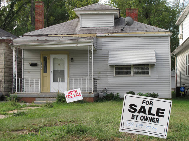 For sale signs have sprouted on the front lawn of what was Muhammad Ali's boyhood home, shown on Monday, Aug. 27, 2012, in Louisville, Ky. The owner says he is asking $50,000 for the small white house in a neighborhood in western Louisville. (AP Photo/Bruce Schreiner)(AP Photo/Bruce Schreiner)