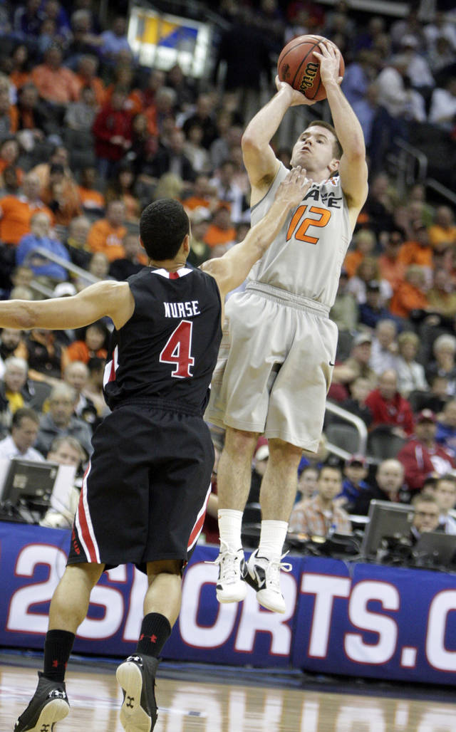 Oklahoma State's Keiton Page (12) shoots over Texas Tech's Ty Nurse (4) during the Big 12 tournament men's basketball game between the Oklahoma State Cowboys and the Texas Tech Red Raiders at the Sprint Center, Wednesday, March, 7, 2012. Photo by Sarah Phipps, The Oklahoman