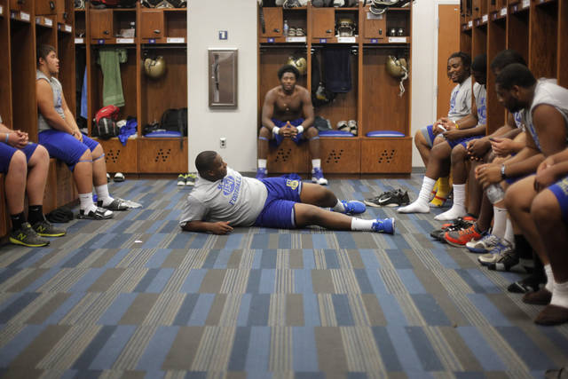 COLLEGE FOOTBALL: NEO teammates gather in a locker room at Northeastern Oklahoma A&M College in Miami, Okla., Wednesday, July 18, 2012.  Photo by Garett Fisbeck, The Oklahoman
