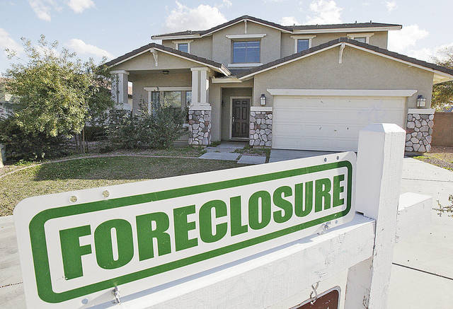 HOUSE EXTERIOR: A foreclosure sign sits outside a home for sale in Phoenix, Tuesday, Feb. 17, 2009. With one of the highest foreclosure rates in the country, Arizona makes a fitting backdrop for President Barack Obama's new housing program, to be unveiled Wednesday.  (AP Photo/Ross D. Franklin) ORG XMIT: AZRF115