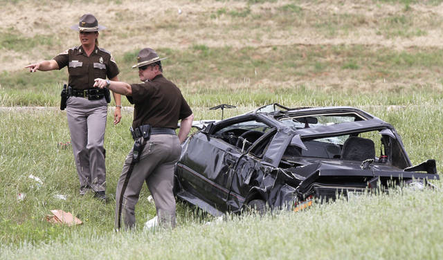 The Oklahoma Highway Patrol investigates a single-car fatality accident which occurred on westbound I-40 at Rockwell Ave. in Oklahoma City, OK, Monday, May 14, 2012,  By Paul Hellstern, The Oklahoman