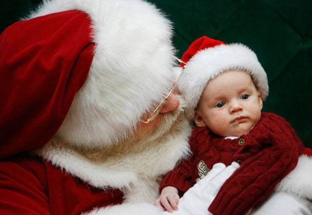 "Santa ( he identified himself only as ""Santa"") holds 3-month-old Luke Pidek at Penn Square Mall Friday afternoon, Dec. 12, 2008.  His parents, Eric and Mindy Pidek, Oklahoma City, brought their newborn son to see Santa for the first time. BY JIM BECKEL, THE OKLAHOMAN"