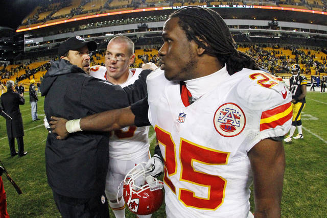 In this photo taken with a fisheye lens, Pittsburgh Steelers offensive coordinator Todd Haley, former head coach of the Kansas City Chiefs, left, talks with Chiefs defensive tackle Shaun Smith, center, and running back Jamaal Charles (25) after an NFL football game in Pittsburgh, Monday, Nov. 12, 2012. The Steelers won 16-13 in overtime. (AP Photo/Gene J. Puskar)
