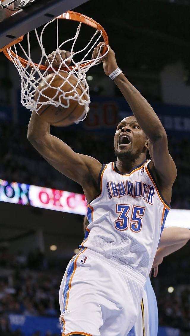 Oklahoma City's Kevin Durant (35) dunks the ball during the NBA basketball game between the Oklahoma City Thunder and the Denver Nuggets at the Chesapeake Energy Arena on Wednesday, Jan. 16, 2013, in Oklahoma City, Okla.  Photo by Chris Landsberger, The Oklahoman